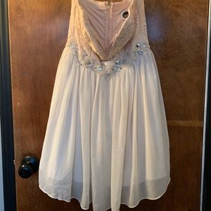 I'm selling a white an blush color dress